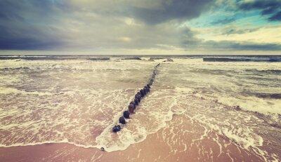 Fototapete Vintage getönten stürmischen Himmel über rauhen Meer.