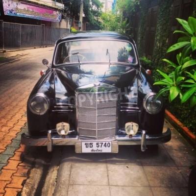 Fototapete Vintage Mercedes Benz car parked in alley
