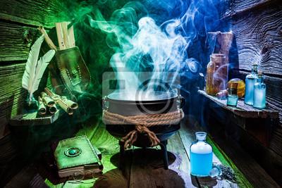 Vintage witcher kessel mit zaubertränke und bücher für halloween ...