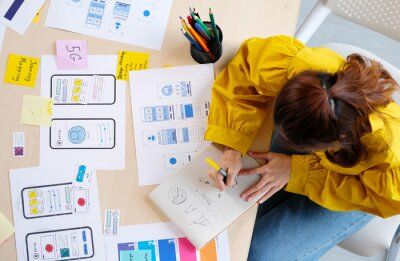 Fototapete Website designer, Creative planning phone app development sketch template layout framework wireframe design, User experience, Overhead view of young woman UX designer thinking out web structure