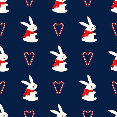 Fototapete Weihnachtshase mit nahtlosem Muster des Zuckerstangenherzens auf dunkelblauem Hintergrund.  Frohes Neues Jahr und Frohe Weihnachten Hintergrund.  Vektordesign für Textil, Geschenkpapier, Stoff.  Tierb