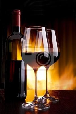 Fototapete Wein im Glas vor dem Kamin mit Feuer