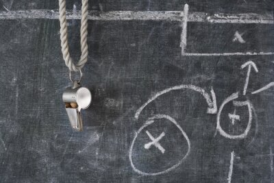 Fototapete whistle of soccer or football referee on a black board with tactical diagram