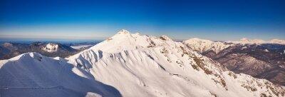 Fototapete Winter Berge Panorama mit Skipisten.