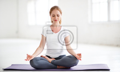 Fototapete woman practicing yoga and meditating in lotus position