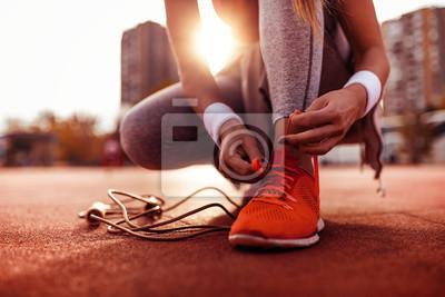 Fototapete Woman preparing for jogging