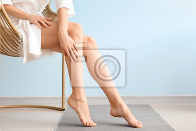 Fototapete Woman with beautiful legs after depilation at home