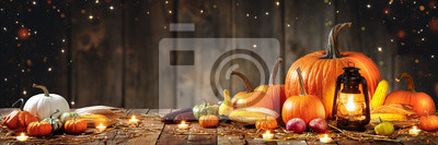 Fototapete Wooden Table With Lantern And Candles Decorated With Pumpkins, Corncobs, Apples And Gourds With Wooden Background - Thanksgiving / Harvest Concept