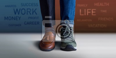 Fototapete Work Life Balance Concept. Low Section of a Man Standing with Half of Working Shoes and Casual Traveling Shoes, Blurred Text on the Wall as background