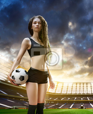 Yong sexy woman player in soccer stadium