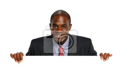 Young African American Businessman Holdin eine leere Zeichen