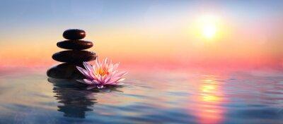 Fototapete Zen Concept - Spa Stones und Waterlily im See bei Sonnenuntergang