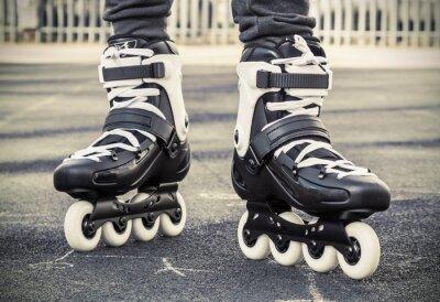 Fototapete zu Fuß auf Rollschuhen zum Skaten. getönten Foto