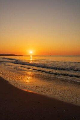 Poster A peaceful sunrise on a beach on the Costa Azahar, Spain