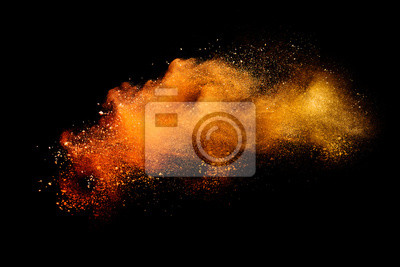 Poster Abstract orange powder explosion isolated on black background.