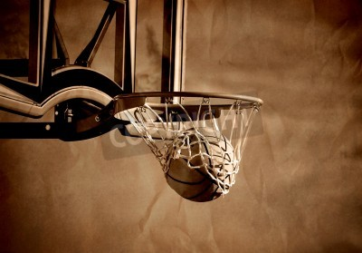 Poster Action shot of basketball going through basketball hoop and net
