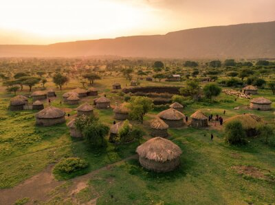 Poster Aerial Drone Shot. Traditional Masai village at Sunset time near Arusha, Tanzania