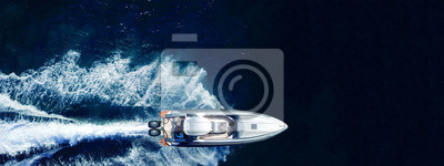 Poster Aerial drone ultra wide top down photo of luxury rigid inflatable speed boat cruising in high speed in Aegean deep blue sea, Greece