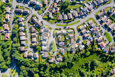 Poster Aerial drone view of small winding sreets and roads in a residential area of a small town