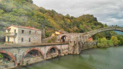 Aerial  view of Devils Bridge - Ponte della Maddalena is a bridge crossing the Serchio river near the town of Lucca