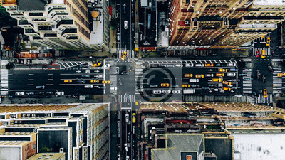 Poster Aerial view of New York downtown building roofs. Bird's eye view from helicopter of cityscape metropolis infrastructure, traffic cars, yellow cabs moving on city streets and crossing district avenues