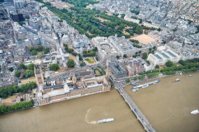 Aerial view of Westminster Palace, Westminster Abbey, Westminster Bridge over River Thames and St James Park from a high vantage point