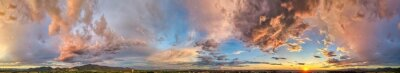 Poster Amazing panoramic aerial view of sunset sky. Beautiful clouds and colors at dusk