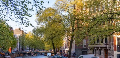 AMSTERDAM - APRIL 30, 2013: Beautiful Amsterdam typical streets and buildings