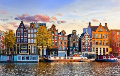 Poster Amsterdam Netherlands dancing houses over river Amstel landmark in old european city spring landscape.