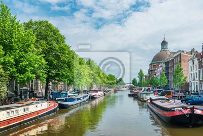 Amsterdam, Netherlands - May 23, 2018: Sightseeing cruise boat in Amsterdam, Netherlands