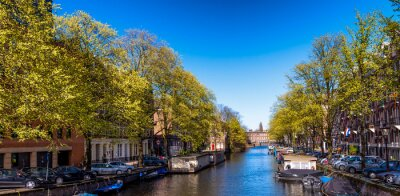 Amsterdam. Wonderful view of city canals and buildings in spring season
