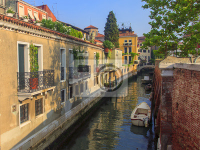 Architecture of ancient Venetian houses built on the canal