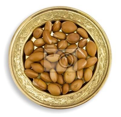 Argan Früchte in einer goldenen Schale
