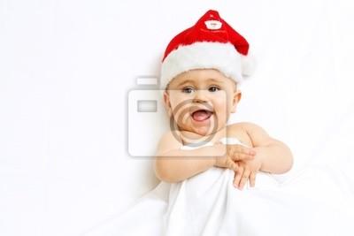 Baby im Bett weihnachtsmann