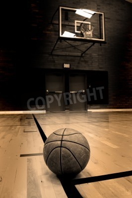 Poster Basketball on court with hoop in the background