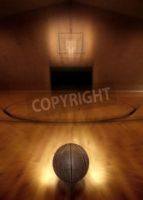 Poster Basketball on floor of empty basketball court