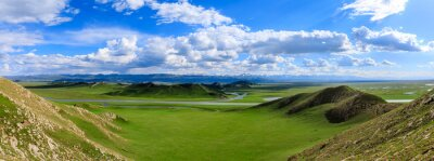Poster Bayinbuluke grassland natural scenery in Xinjiang,China.The winding river is on the green grassland.Panoramic view.
