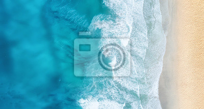 Poster Beach and waves from top view. Turquoise water background from top view. Summer seascape from air. Top view from drone. Travel concept and idea