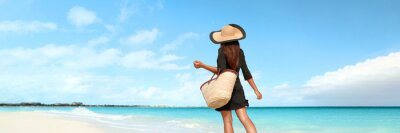 Poster Beach vacation luxury travel woman tourist walking on pristine resort holiday hotel waterfront banner panoramic. Caribbean summer getaway lifestyle.