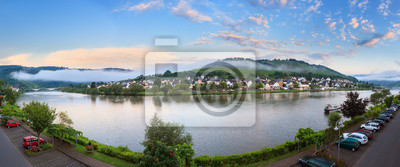 Beautiful 180 degree panoramic sunrise view of the river Moselle at the small wine growing town Zell (an der Mosel) on a summer morning