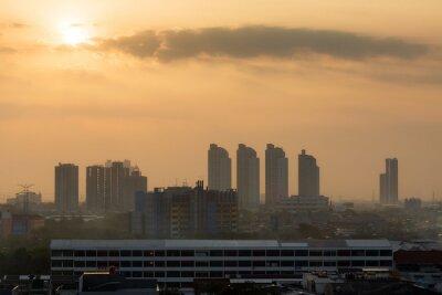 Beautiful aerial cityscape view of the skyline of Jakarta (seen from Kota tua aka old town or Batavia), Indonesia, at sunrise