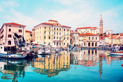 Beautiful amazing city scenery on the waterfront with boats in Piran, the tourist center of Slovenia. popular tourist attraction. Wonderful exciting places.