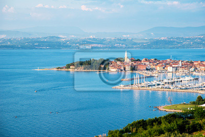 Beautiful amazing city scenery with boats in the bay in Izola, Slovenia. Wonderful exciting places. (vacation, rest - concept)
