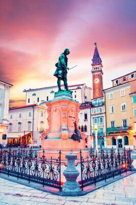 Beautiful amazing city scenery with the monument the famous Italian violinist and composer Giuseppe Tartini in the central square in Piran, the tourist center of Slovenia. popular tourist attraction