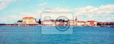 Beautiful amazing city scenery with the old tower in Porec, the tourist center of Croatia from sea. popular tourist attraction. Wonderful exciting places. (vacation, rest - concept)