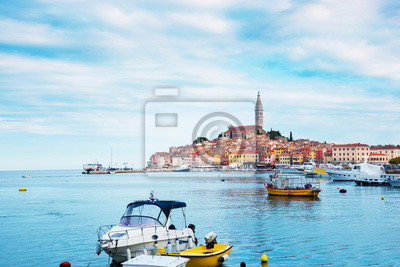 Beautiful city landscape with sea boats, colorful houses and an ancient tower in Rovinj, Croatia, Europe. (vacation, rest - concept)