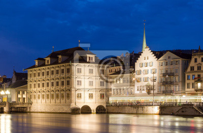 Beautiful cityscape of Zurich, Switzerland, with the Zürich Town Hall (Rathaus), seen from the shore of the river Limmat in the blue hour in summer