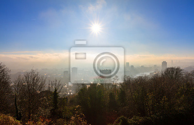 Beautiful cityscape panorama view of the skyline of Liege, Belgium, with the river Meuse on a sunny and hazy winter morning seen from the top of the Montagne de Bueren