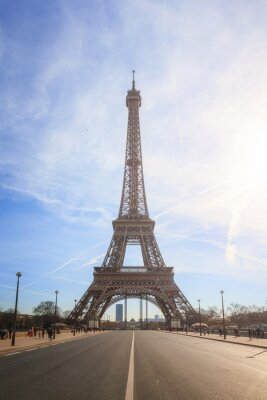 Beautiful cityscape urban street view of the Eiffel tower in Paris, France, on a spring day