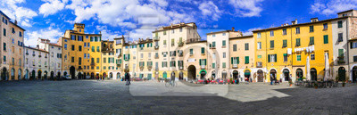 Beautiful colorful square - Piazza dell Anfiteatro in Lucca. Tuscany, Italy